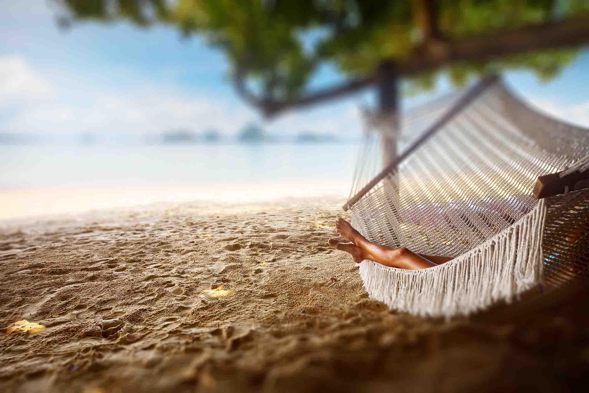 lying in a hammock by the beach