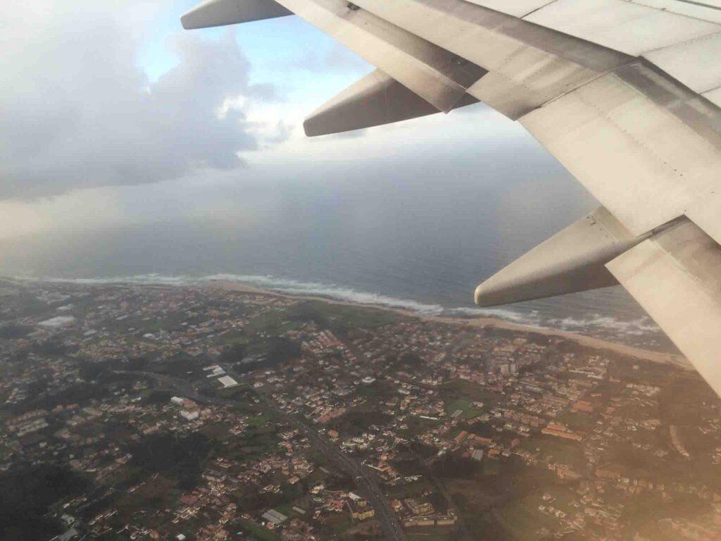 Plane wing over Faro