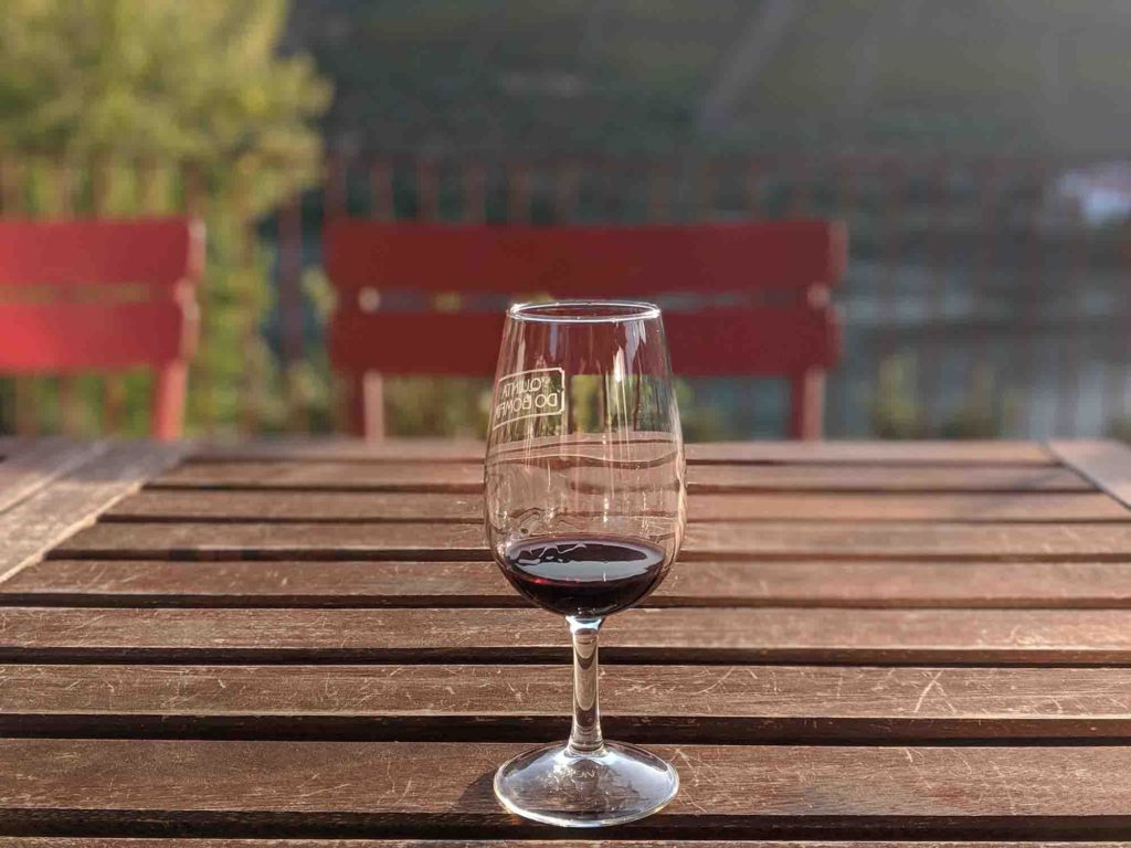 Port wine glass by the river