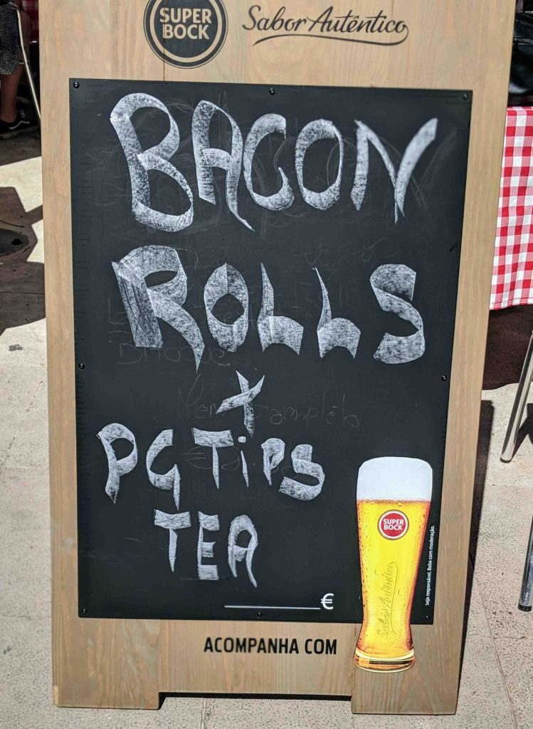 sign advertising bacon rolls and pg tips