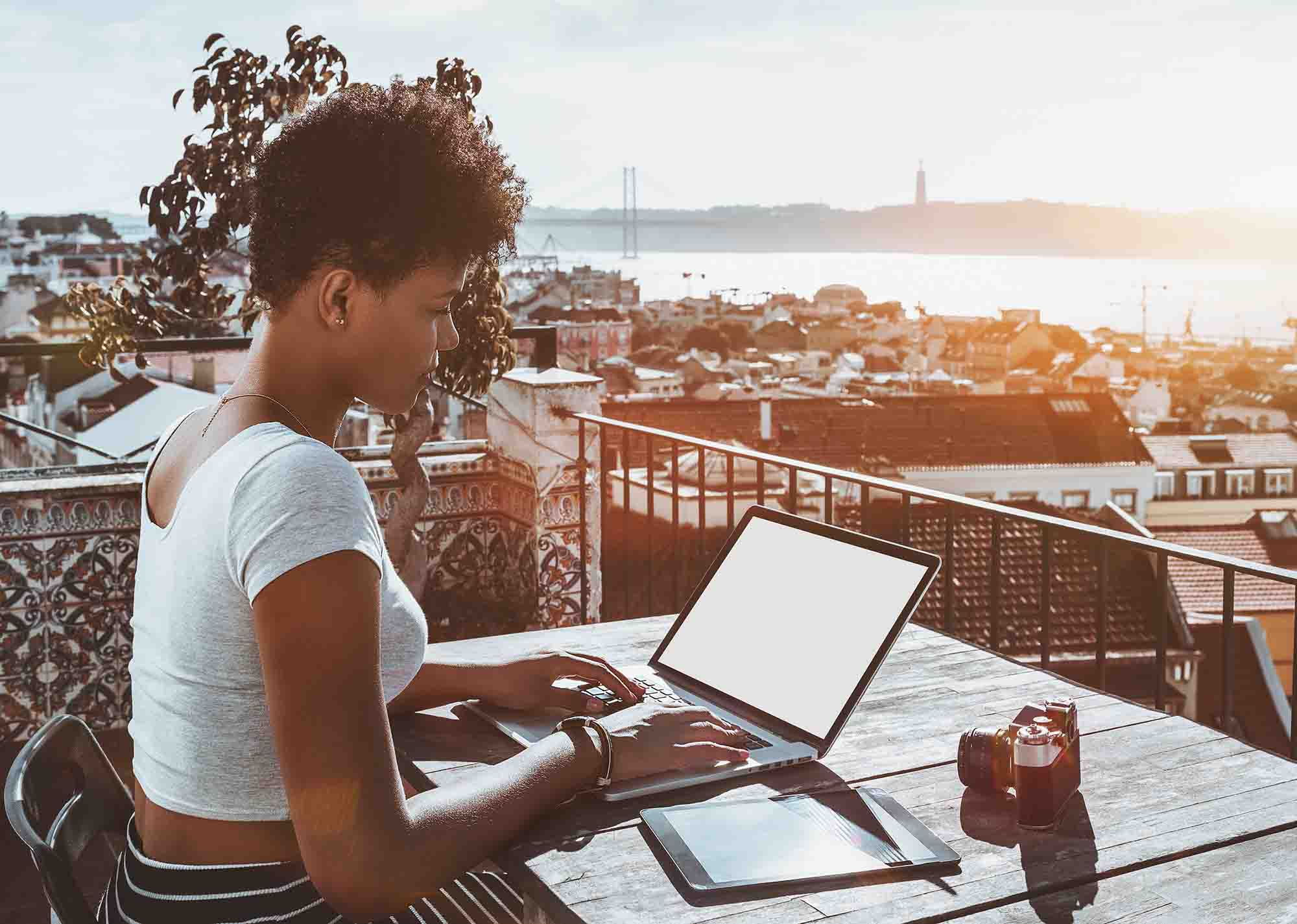 working on laptop from balcony in Lisbon