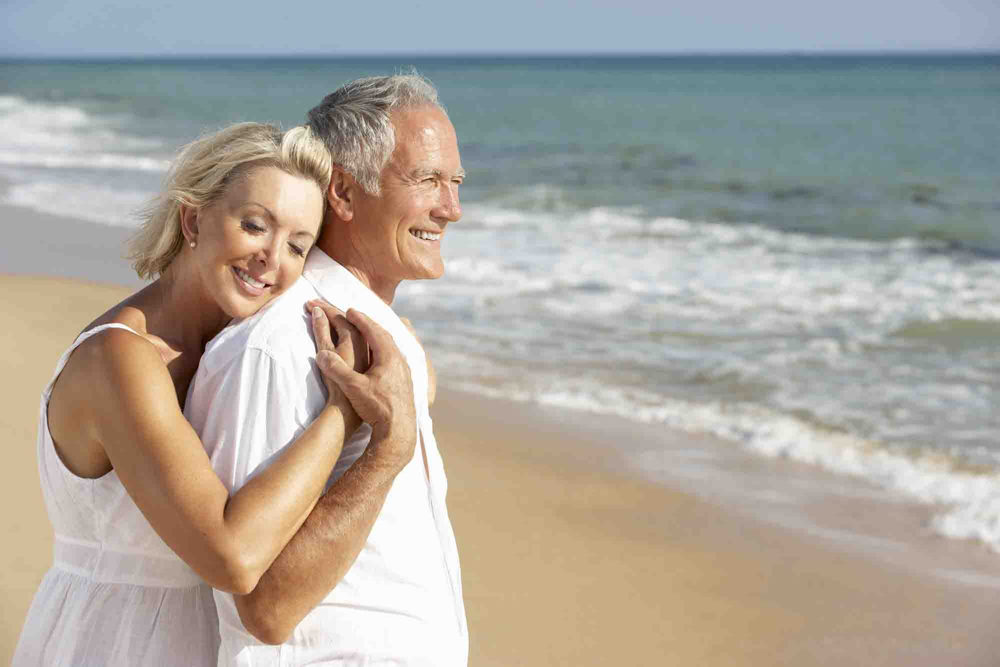 older couple enjoying the beach