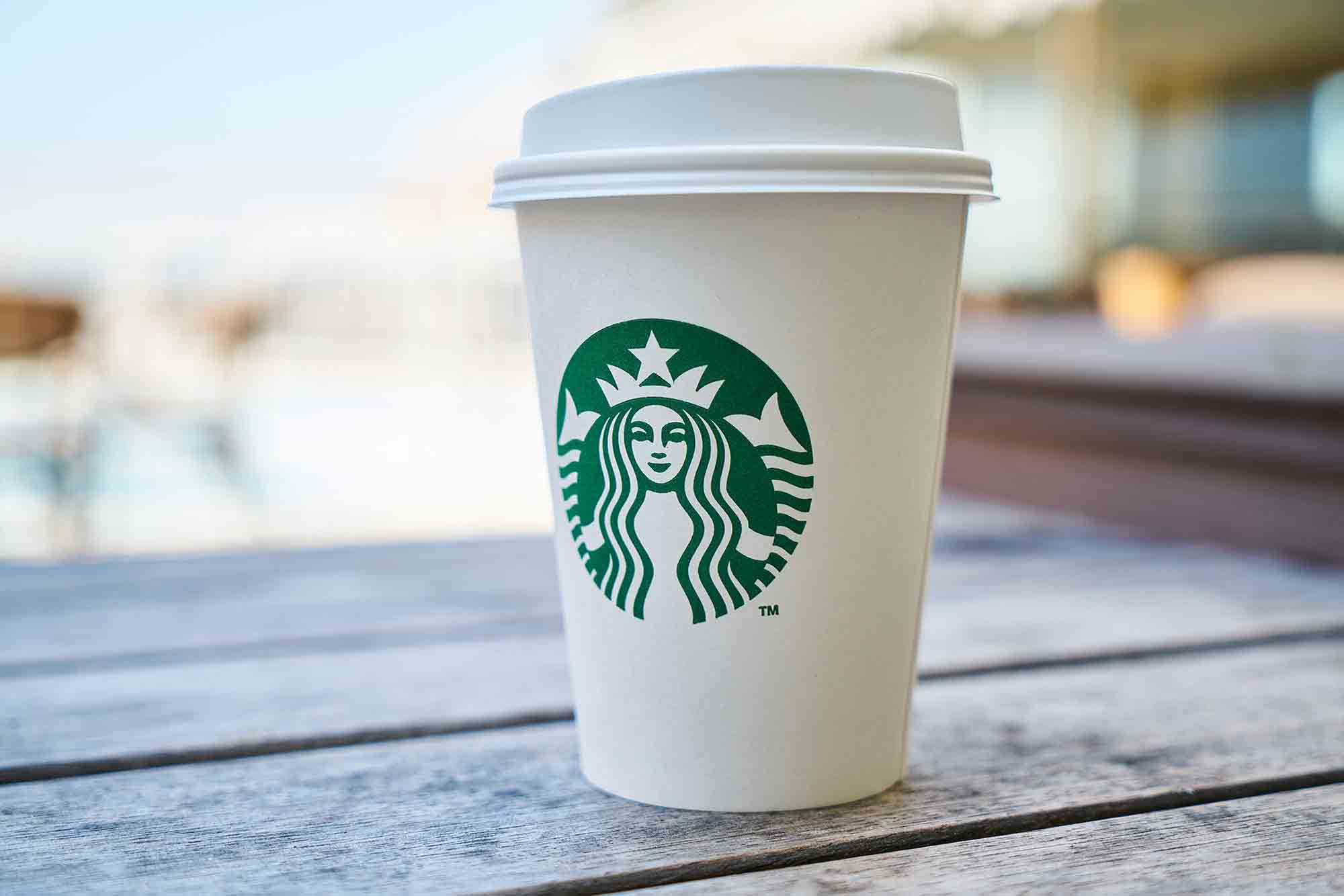 starbucks cup on bench